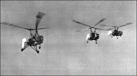 The original K-125 prototype Kaman helicopter (left) is here seen flying in company with two of the later, higher-powered K-190s