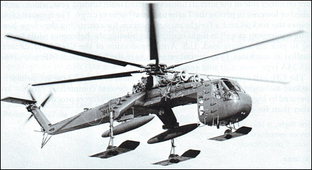 One of three CH-54B Tarhe helicopters fitted with skis in 1971 for evaluation by the Army in Alaska. Two auxiliary fuel tanks are also fitted. Note the side windows for the rear-facing cockpit of the freight master.